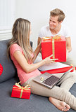 Happy couple exchanging gifts