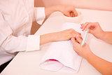 Woman receiving manicure treatment