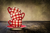 Colorful coffee cups on the table in vintage style