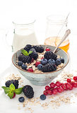 Healthy breakfast with granola and fresh berries