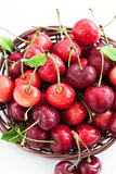 Fresh wet cherry in a basket