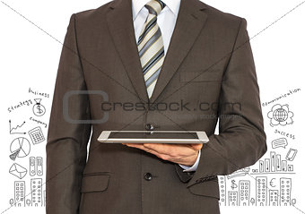 Man with tablet in hand and business sketches