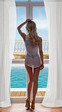 girl with sexy lingerie near window