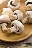 button mushrooms on plate