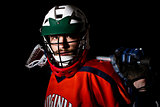 Lacrosse player wearing helmet and holding stick.
