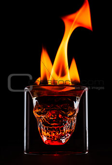 Skull shape glass with flames on the top