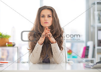 Portrait of thoughtful business woman at work