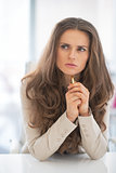 Portrait of thoughtful business woman in office looking on copy