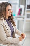 Portrait of happy business woman in office