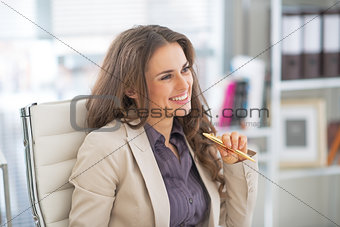 Portrait of happy business woman in office