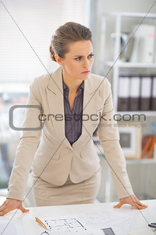Portrait of thoughtful business woman in office