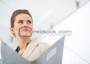 Portrait of business woman with folder