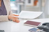 Closeup on business woman giving document