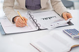 Closeup on business woman working with documents