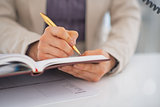 Closeup on business woman writing in diary