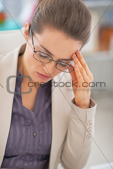 Portrait of frustrated business woman with eyeglasses in office