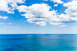 blue cloudy sky over the blue sea