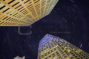 Skyscrapers and star trails
