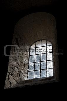 old castle window in darkness