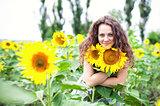 The girl among sunflowers