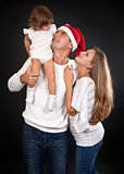 family on a black background, Santa's hat with dad.