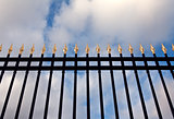 steel fence with gold spears