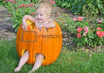 baby girl in pumpkin