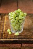 fresh ripe green gooseberries on wooden table