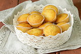 homemade vanilla muffins in a basket of lace napkins