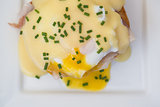 Eggs Benedict toasted English muffins ham poached eggs
