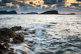 Sunrise over rocky coastline on Mediterranean Sea landscape