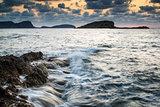 Sunrise over rocky coastline on Mediterranean Sea landscape