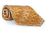 beige trim tie rolled up on a white background