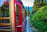 Vintage train eith red carriages cogwheel railway going to Schaf