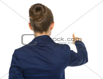 Business woman pointing. rear view