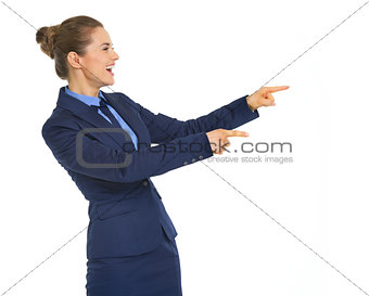 Portrait of thoughtful business woman pointing on copy space