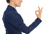 Closeup on business woman showing ok gesture