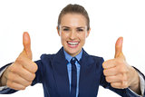 Business woman showing thumbs up