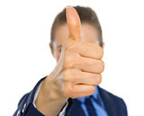 Business woman showing thumbs up in front of face