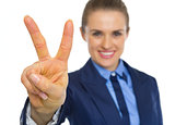 Closeup on business woman showing victory gesture