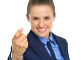 Closeup on business woman beckoning with finger