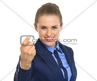 Portrait of happy business woman beckoning with finger