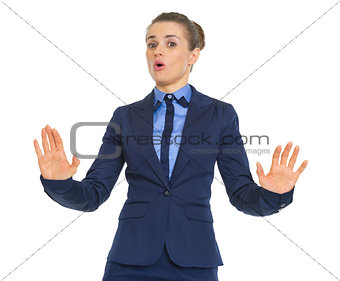 Business woman showing hold on gesture