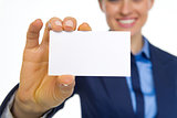 Closeup on happy business woman showing business card