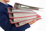 Closeup on business woman holding folders