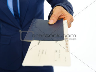 Closeup on business woman giving passport with ticket