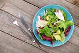 Fresh healthy salad and silverware