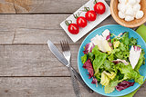 Fresh healthy salad with tomatoes and mozzarella
