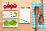 Fresh healthy salad, tomatoes, mozzarella and notepad for copy s
