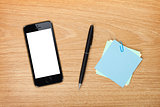 Office table with mobile phone and supplies